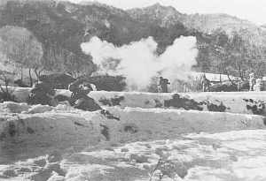 Chinese forces attack Lt. Col. Don Faith's position along the Chosin Reservoir in late 1950. Photo credit: Wikipedia.