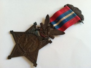 Photo of original Medal of Honor awarded to Joshua Chamberlain of Maine in 1893 for heroism at Gettysburg 30 years earlier. Photo credit: Bangor Daily News.