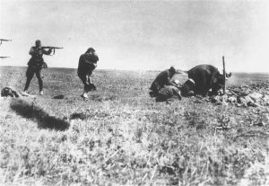 Einsatzgruppen, Nazi mobile killing units, shooting Ukrainian peasants in 1941.