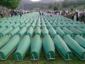 Burial of 775 identified victims of Srebrenica massacre in 2010.