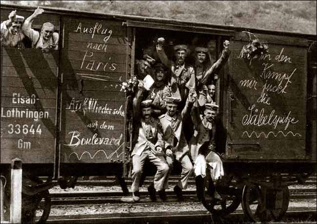German_soldiers_in_a_railroad_car_on_the_way_to_the_front_during_early_World_War_I,_taken_in_1914__Taken_from_greatwar_nl_site