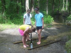 Daughters 3, 4 and 5 partake in the waters of God's Acre Healing Springs last year.