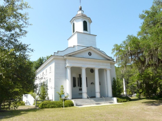 Presbyterian Church on Edisto Island. The memorial to victims of Pulaski disaster can be seen to the right of the church.