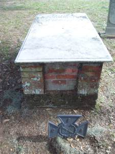 Box vault of Laurence Dunphey in Catholic Cemetery, Savannah, Ga. Note Southern Cross of Honor in front of grave, apparently depicting belief that Dunphey, who died in 1834 at the purported age of 145, also managed to fight in the US Civil War (1861-65).