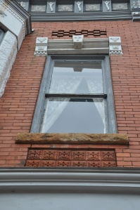 Window on T.C. Hogue Building, built in 1895 and located in Washington Court Square.